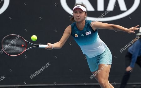 China's Peng Shuai makes a forehand return to Canada's Eugenie Bouchard during their first round match at the Australian Open tennis championships in Melbourne, Australia
