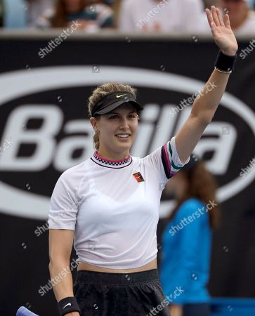 Canada's Eugenie Bouchard celebrates after defeating China's Peng Shuai in their first round match at the Australian Open tennis championships in Melbourne, Australia