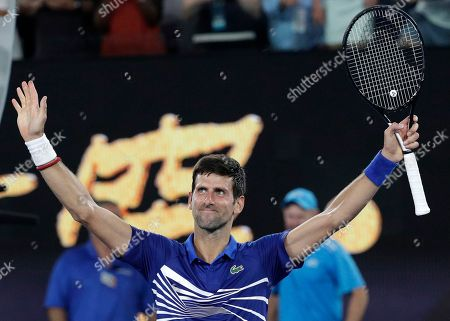 Serbia's Novak Djokovic celebrates after defeating United States' Mitchell Krueger in their first round match at the Australian Open tennis championships in Melbourne, Australia