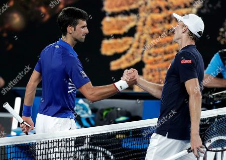 Serbia's Novak Djokovic, left, is congratulated by United States' Mitchell Krueger after winning their first round match at the Australian Open tennis championships in Melbourne, Australia
