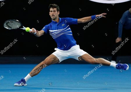 Serbia's Novak Djokovic hits a forehand return to United States' Mitchell Krueger during their first round match at the Australian Open tennis championships in Melbourne, Australia