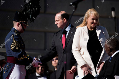 Alan Wilson, Jennifer Wilson. South Carolina Attorney General Alan Wilson, center, shakes the hand of a cadet from The Citadel as his wife, Jennifer Wilson, takes her seat during inauguration ceremonies for Governor Henry McMaster at the South Carolina Statehouse, in Columbia, S.C