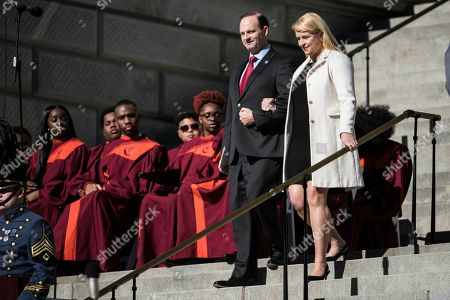 Alan Wilson, Jennifer Wilson. South Carolina Attorney General Alan Wilson, left, and his wife, Jennifer Wilson, walk down steps during inauguration ceremonies for Governor Henry McMaster at the South Carolina Statehouse, in Columbia, S.C