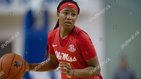 Mississippi guard Crystal Allen (5) dribbles the ball during an NCAA basketball game against Kentucky, in Lexington, Ky