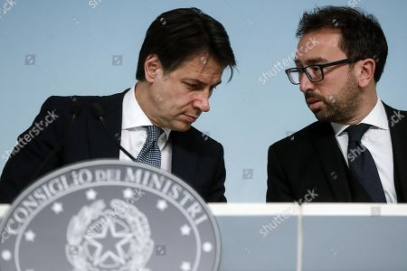 Italian Premier Giuseppe Conte (L) and the Minister of Justice Alfonso Bonafede during the press conference about the arrest of the Italian fugitive Cesare Battisti in Rome, Italy, 14 January 2019. Cesare Battisti, 64, a former member of the far-left terrorist group Armed Proletarians for Communism (PAC), was arrested in Bolivia after 38-years as a fugitive of the Italian justice. He is set to serve a life sentence for four murders committed in Italy's 'years of lead' of political violence in the 1970s and 1980s, media reported.