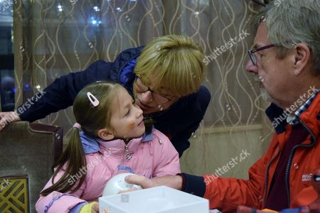 Alice and Jack Simpson with their British grandparents Ian and Linda on Christmas Day