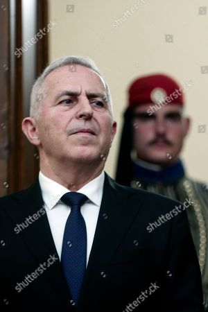 Greece's newly appointed Defense Minister Evangelos Apostolakis, attends a swearing-in ceremony in Athens, on . The 62-year-old retired admiral left his post as head of the country's armed forces to replace Panos Kammenos, leader of a small nationalist party, who withdrew from the government coalition at the weekend over disagreement on a proposed deal between Greece and neighbor Macedonia