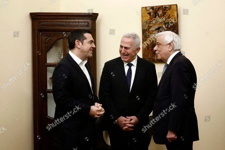 Greek President Prokopis Pavlopoulos (R) and Greek Prime Minister Alexis Tsipras (L) during the swearing-in ceremony of new Greek Defense Minister Admiral Evangelos Apostolakis (C) at the Presidential Palace in Athens, Greece, 14 January 2019. Following the resignation of Panos Kammenos as defense minister, Prime Minister Alexis Tsipras on Sunday announced that the leadership of Greece's defense ministry will go to the current commander of the armed forces, Hellenic National Defense General Staff chief Admiral Evangelos Apostolakis.