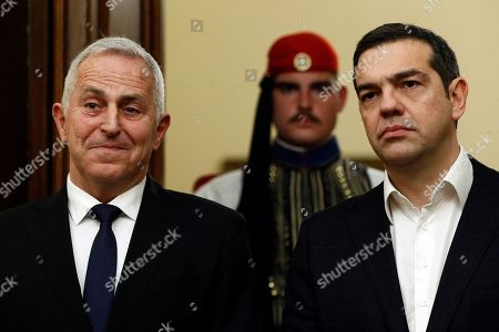 Greek Prime Minister Alexis Tsipras (R) talks with the new Greek Defense Minister Admiral Evangelos Apostolakis (L) during his swearing-in ceremony at the Presidential Palace in Athens, Greece, 14 January 2019. Following the resignation of Panos Kammenos as defense minister, Prime Minister Alexis Tsipras on Sunday announced that the leadership of Greece's defense ministry will go to the current commander of the armed forces, Hellenic National defense General Staff chief Admiral Evangelos Apostolakis.