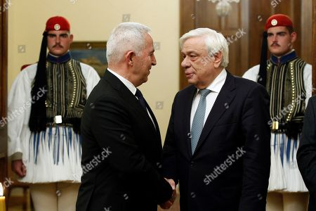 Greek President Prokopis Pavlopoulos (R) talks with the new Greek Defense Minister Admiral Evangelos Apostolakis (L) during his swearing-in ceremony at the Presidential Palace in Athens, Greece, 14 January 2019. Following the resignation of Panos Kammenos as defense minister, Prime Minister Alexis Tsipras on Sunday announced that the leadership of Greece's defense ministry will go to the current commander of the armed forces, Hellenic National defense General Staff chief Admiral Evangelos Apostolakis.