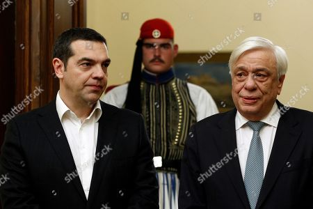 Greek President Prokopis Pavlopoulos (R) and Greek Prime Minister Alexis Tsipras (L) during the swearing-in ceremony of new Greek Defense Minister Admiral Evangelos Apostolakis (not pictured) at the Presidential Palace in Athens, Greece, 14 January 2019. Following the resignation of Panos Kammenos as defense minister, Prime Minister Alexis Tsipras on Sunday announced that the leadership of Greece's defense ministry will go to the current commander of the armed forces, Hellenic National defense General Staff chief Admiral Evangelos Apostolakis.
