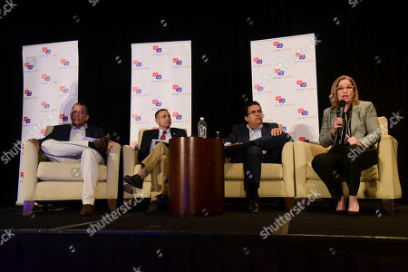 From left, Mayor Bernardo Marquez Garcia from Toa Baja, Mayor Pedro Garcia Figueroa from Hormigueros, Mayor Javier Jimenez from San Sebastian and Mayor Carmen Yulin Cruz Soto from San Juan, hold a panel about Hurricane Maria during the annual Latino Political Summit in San Juan, Puerto Rico