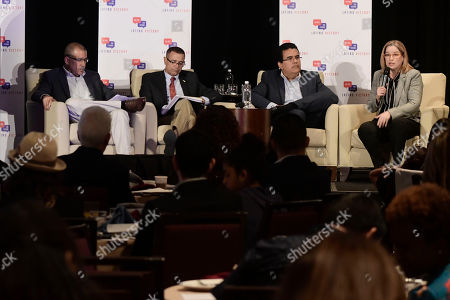From left, Mayor Bernardo Marquez Garcia from Toa Baja, Mayor Pedro Garcia Figueroa from Hormigueros, Mayor Javier Jimenez from San Sebastian and Mayor Carmen Yulin Cruz Soto from San Juan, speak on a panel about Hurricane Maria during the annual Latino Political Summit in San Juan, Puerto Rico