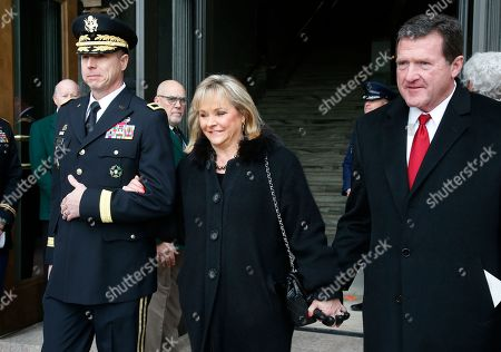Stock Photo of Former Oklahoma Governor Mary Fallin, center, arrives with her husband, Wade Christensen, right, for the inauguraiton ceremonies of Oklahoma Governor Kevit Stitt in Oklahoma City