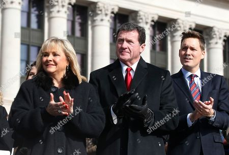 Former Oklanoma Governor Mary Fallin, left, her husband Wade Christensen, center, and Oklahoma Lt. Governor Matt Pinnell, right, applaud during inauguration ceremonies in Oklahoma City