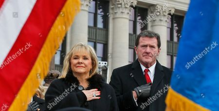 Mary Fallin, Wade Christensen. Former Oklahoma Governor Mary Fallin, left, and her husband, Wade Christensen, right, hold their hands over their hearts during the playing of the national anthem during the inauguration of Oklahoma Governor Kevin Stitt in Oklahoma City