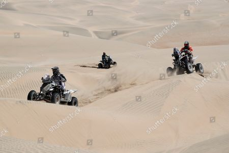 Stock Photo of Manuel Andujar of Argentina rides his Yamaha quad followed by Gustavo Gallego, also of Argentina, during the stage seven of the Dakar Rally in San Juan de Marcona, Peru