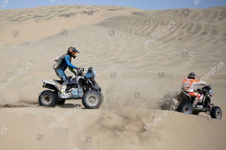 Jeremias Gonzalez of Argentina rides his Yamaha quad following Yamaha rider Gustavo Gallego, also of Argentina, during the stage seven of the Dakar Rally in San Juan de Marcona, Peru