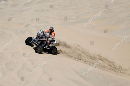 Gustavo Gallego of Argentina rides his Yamaha quad during the stage seven of the Dakar Rally in San Juan de Marcona, Peru