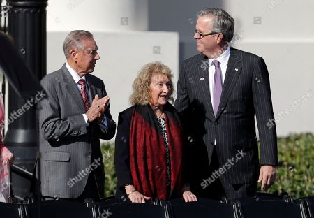 Former Governors Bob Martinez, left, and Jeb Bush, right, arrive for an inauguration ceremony, in Tallahassee, Fla. Republicans will begin their third decade dominating the state's Capitol