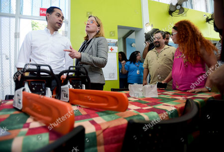 San Juan Mayor Carmen Yulin Cruz Soto, second from left, talks with Julian Castro as they tour \ the Playita Community Transformation Center, which is equipped with solar panels, medicine, water purifiers, batteries, solar powered lights and other resources, in order to respond to future emergencies like Hurricane Maria, in San Juan, Puerto Rico, . The U.S. presidential candidate has joined dozens of high-profile Latinos in Puerto Rico to talk about mobilizing voters ahead of the 2020 elections and increasing Latino political representation to take on President Donald Trump