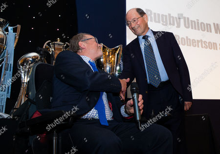 Stock Image of Ed Marriage (out of shot) & Alastair Hignell  discuss Ian Robertson 's (Robbo) retirement from BBC Rugby commentary