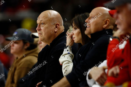 Former Baltimore Oriole Cal Ripken Jr. sits courtside in the first half of an NCAA college basketball game between Maryland and Wisconsin, in College Park, Md