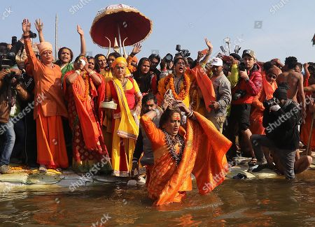 Head of Kinnar Akhara, a transgender congregation, Laxmi Narayan Tripathi (C, front) and members take a 'shahi snans' or holy bath at the Sangam river, the confluence of three of the holiest rivers in Hindu mythology, the Ganga, the Yamuna and the Saraswati, during Kumbh Mela festival in Allahabad, Uttar Pradesh, India, 15 January 2019. The Hindu festival is one of the biggest in India and will be held from 15 January to 04 March 2019 in Allahabad.