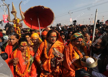 epa07285384 Head of Kinnar Akhara, a transgender congregation, Laxmi Narayan Tripathi (C) and members arrive to take a 'shahi snans' or holy bath at the Sangam river, the confluence of three of the holiest rivers in Hindu mythology, the Ganga, the Yamuna and the Saraswati, during Kumbh Mela festival in Allahabad, Uttar Pradesh, India, 15 January 2019. The Hindu festival is one of the biggest in India and will be held from 15 January to 04 March 2019 in Allahabad.