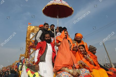Head of Kinnar Akhara, a transgender congregation, Laxmi Narayan Tripathi (C) and members arrive to take a 'shahi snans' or holy bath at the Sangam river, the confluence of three of the holiest rivers in Hindu mythology, the Ganga, the Yamuna and the Saraswati, during Kumbh Mela festival in Allahabad, Uttar Pradesh, India, 15 January 2019. The Hindu festival is one of the biggest in India and will be held from 15 January to 04 March 2019 in Allahabad.