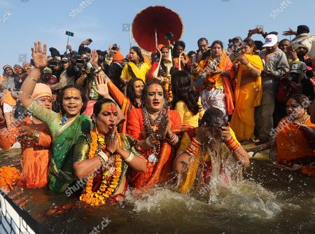 Head of Kinnar Akhara, a transgender congregation, Laxmi Narayan Tripathi (C) and members take a 'shahi snans' or holy bath at the Sangam river, the confluence of three of the holiest rivers in Hindu mythology, the Ganga, the Yamuna and the Saraswati, during Kumbh Mela festival in Allahabad, Uttar Pradesh, India, 15 January 2019. The Hindu festival is one of the biggest in India and will be held from 15 January to 04 March 2019 in Allahabad.