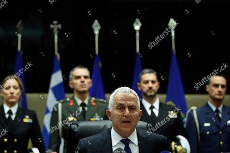 Newly appointed Defense Minister Evangelos Apostolakis, makes statements during the handover ceremony in Athens, . The 62-year-old retired admiral left his post as head of the country's armed forces to replace Panos Kammenos, leader of a small nationalist party, who withdrew from the government coalition at the weekend over disagreement on a proposed deal between Greece and neighbor Macedonia. Greece's parliament has scheduled a confidence vote for late Wednesday following the collapse of Prime Minister Alexis Tsipras' governing coalition over a proposed deal to end a decades-old dispute with Macedonia