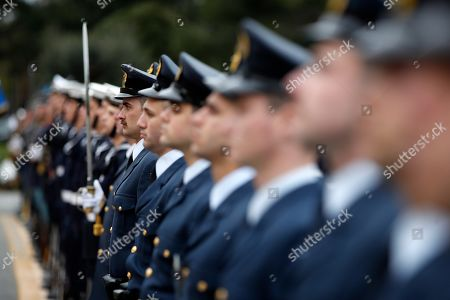The guard of honor stand during the handover ceremony at the Defense Ministry in Athens, . during the handover ceremony in Athens, Tuesday, Jan. 15, 2019. Newly appointed Defense Minister Evangelos Apostolakis retired admiral left his post as head of the country's armed forces to replace Panos Kammenos, leader of a small nationalist party, who withdrew from the government coalition at the weekend over disagreement on a proposed deal between Greece and neighbor Macedonia. Greece's parliament has scheduled a confidence vote for late Wednesday following the collapse of Prime Minister Alexis Tsipras' governing coalition over a proposed deal to end a decades-old dispute with Macedonia