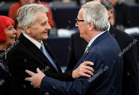 Former European Central Bank President Jean-Claude Trichet (L) hugs Jean-Claude Juncker, President of the European Commission (R), at the European Parliament in Strasbourg, France, 15 January 2019,  after the commemoration of twenty years of the Euro.