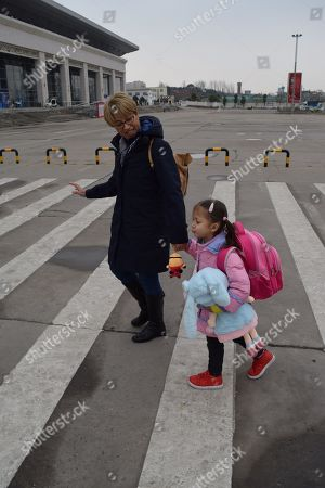 Alice Simpson sets off from Nanzhang station on the first leg of her journey to England with grandparents Ian and Linda