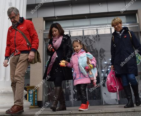 Alice Simpson leaves court on Boxing Day morning with grandparents Linda and Michael Simpson and family laywer Fang Jie