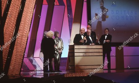 Stock Photo of Lifetime achievement award for film comedy awarded to Peter Rogers (Producer, the Carry On films producer), with Barbara Windsor, Liz Fraser, Kenneth Connor, Bernard Bresslaw and Sir Michael Parkinson.