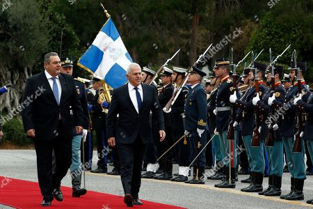 Former Greek Defense Minister Panos Kammenos (L) with newly appointed Admiral Evangelos Apostolakis (R) inspect the honour guards during a switchover ceremony at the National Defence Ministry, in Athens, Greece, 15 January 2019. Following the resignation of Panos Kammenos as defence minister, Prime Minister Alexis Tsipras on Sunday announced that the leadership of Greece's defence ministry will go to the current commander of the armed forces, Hellenic National Defence General Staff chief Admiral Evangelos Apostolakis.