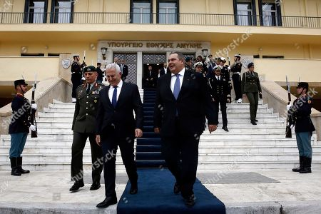 Former Greek Defense Minister Panos Kammenos (C-L) with newly appointed Admiral Evangelos Apostolakis (C-R) inspect the honour guards during a switchover ceremony at the National Defence Ministry, in Athens, Greece, 15 January 2019. Following the resignation of Panos Kammenos as defence minister, Prime Minister Alexis Tsipras on Sunday announced that the leadership of Greece's defence ministry will go to the current commander of the armed forces, Hellenic National Defence General Staff chief Admiral Evangelos Apostolakis.