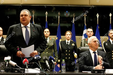 Stock Picture of Former Greek Defense Minister Panos Kammenos (L) with newly appointed Admiral Evangelos Apostolakis (R) address to the media during a switchover ceremony at the National Defence Ministry, in Athens, Greece, 15 January 2019. Following the resignation of Panos Kammenos as defence minister, Prime Minister Alexis Tsipras on Sunday announced that the leadership of Greece's defence ministry will go to the current commander of the armed forces, Hellenic National Defence General Staff chief Admiral Evangelos Apostolakis.