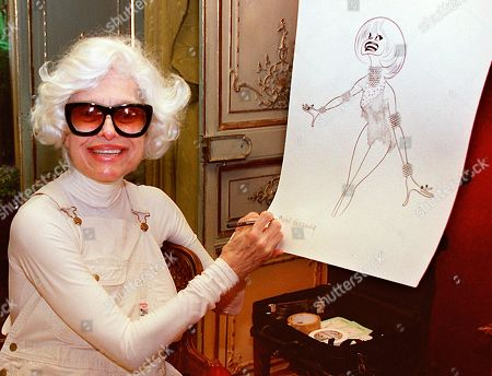 Stock Image of CAROL CHANNING HERSCHFELD. Actress Carol Channing hand-signs a lithograph of herself by caricaturist Al Hirschfeld at her home in Beverly Hills, Calif. Channing, whose career spanned decades on Broadway and on television has died at age 97. Publicist B. Harlan Boll says Channing died of natural causes early in Rancho Mirage, Calif