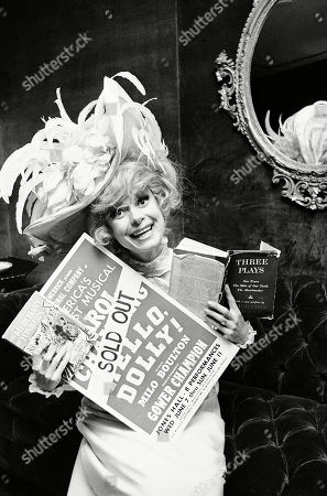 "Carol Channing holds a sold out advertisement poster of ""Hello, Dolly"" in Houston. Channing, whose career spanned decades on Broadway and on television has died at age 97. Publicist B. Harlan Boll says Channing died of natural causes early in Rancho Mirage, Calif"
