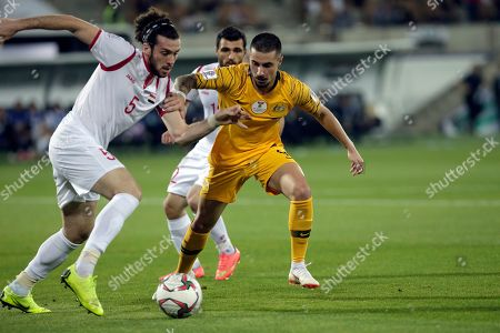 Australia's forward Jamie Maclaren, right, duels for the ball with Syria's defender Omro Midani during the AFC Asian Cup group B soccer match between Australia and Syria at the Khalifa bin Zayed Stadium in Al Ain, United Arab Emirates