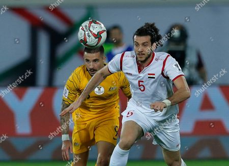 Syria's defender Omro Midani, right, challenges for the ball with Australia's forward Jamie Maclaren, left, during the AFC Asian Cup group B soccer match between Australia and Syria at the Khalifa bin Zayed Stadium in Al Ain, United Arab Emirates