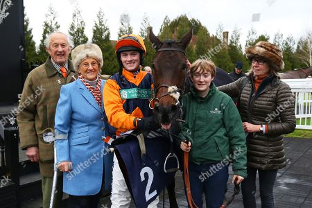 Stock Image of POTTERS MIDNIGHT ridden by Jack Quinlan with Lucy Wadham (right) & owners Mr and Mrs May after winning The Read Davy Russell's Exclusive Blog starsportsbet.co.uk Handicap Hurdle at Lingfield Copyright: Ian Headington/racingfotos.com