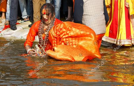 Laxmi Narayan Tripathi, transgender activist and chief of the Kinnar Akhara, takes a ritualistic dip on the auspicious Makar Sankranti day during the Kumbh Mela, or pitcher festival, in Prayagraj, Uttar Pradesh state, India, . The Kumbh Mela is a series of ritual baths by Hindu holy men, and other pilgrims at the confluence of three sacred rivers ? the Yamuna, the Ganges and the mythical Saraswati ? that dates back to at least medieval times. The city's Mughal-era name Allahabad was recently changed to Prayagraj