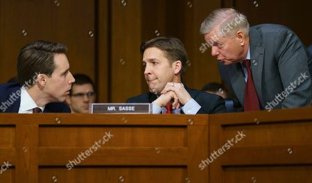 Lindsey Graham, Ben Sasse, Josh Hawley. Senate Judiciary Committee Chairman Lindsey Graham, R-S.C., right, speaks with Sen. Ben Sasse, R-Neb., center, and Sen. Josh Hawley, R-Mo., left, as Attorney General nominee William Barr testifies before the Senate Judiciary Committee on Capitol Hill in Washington