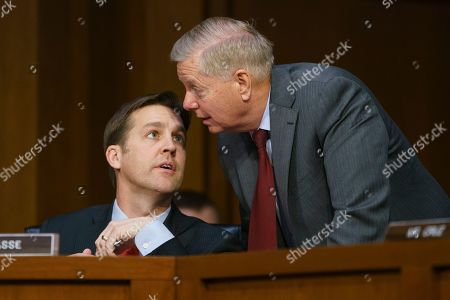 Lindsey Graham, Ben Sasse. Senate Judiciary Committee Chairman Lindsey Graham, R-S.C., right, speaks with Sen. Ben Sasse, R-Neb., as Attorney General nominee William Barr testifies before the Senate Judiciary Committee on Capitol Hill in Washington