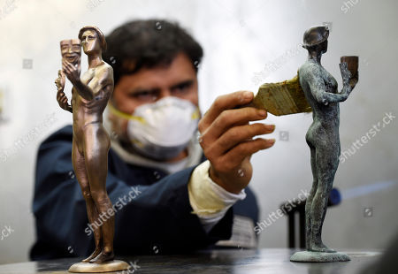 Foundry worker Ricardo Gortinez applies a blue-green patina to an Actor statuette during the 25th Annual Casting of the Screen Actors Guild Awards at American Fine Arts Foundry, in Burbank, Calif. The SAG Awards will held on Sunday, Jan. 27 in Los Angeles