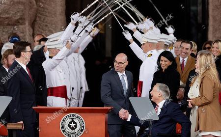 Stock Photo of Greg Abbott, Dennis Bonnen, Dan Patrick. House Speaker Dennis Bonnen, center, congratulates Gov. Greg Abbott, right, and Texas Lt. Gov. Dan Patrick, left, during their inauguration ceremony, in Austin, Texas